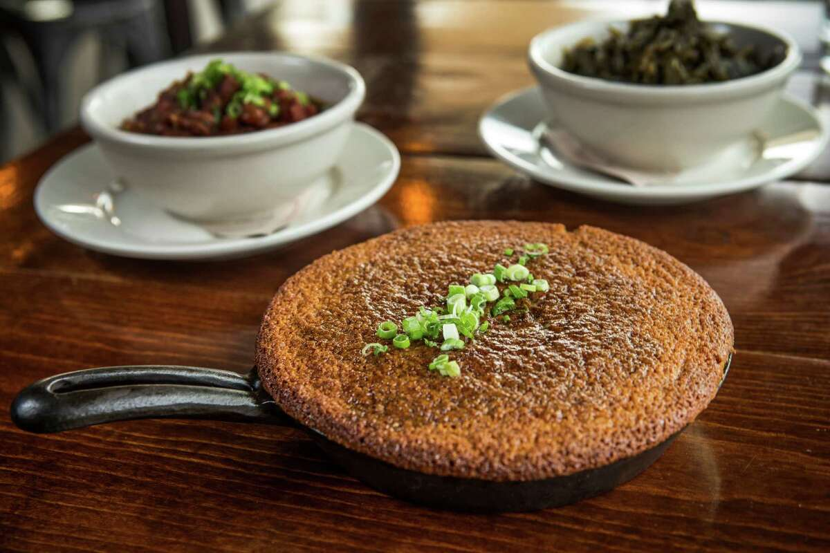 Sides include skillet cornbread, red beans and rice, and braised greens.