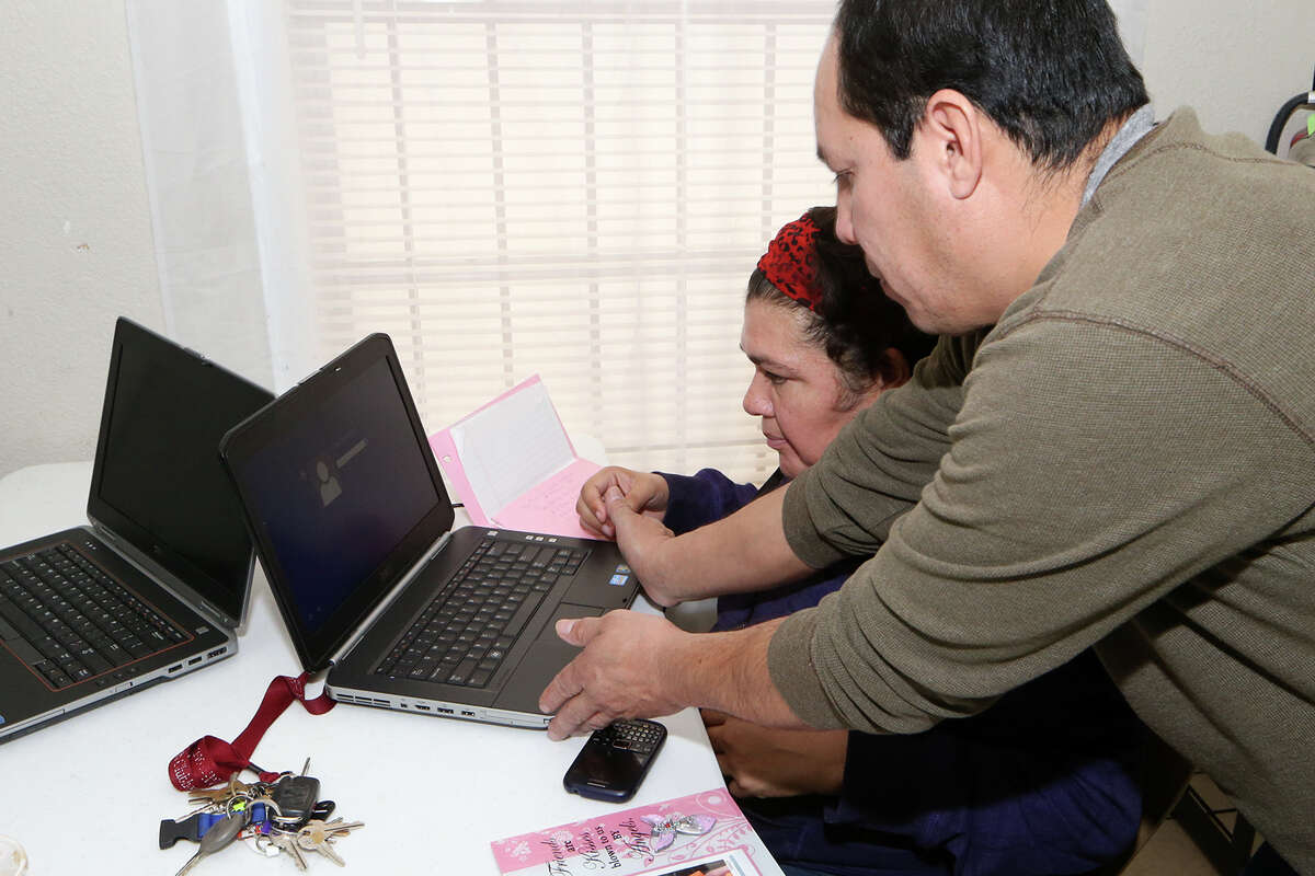 Jorge Ramirez (right) helps Patricia Favella log on to a laptop at SA Clubhouse Las Palmas, 4126 San Luis St., at the Las Palmas Church of the Nazarene on March 3, 2015.