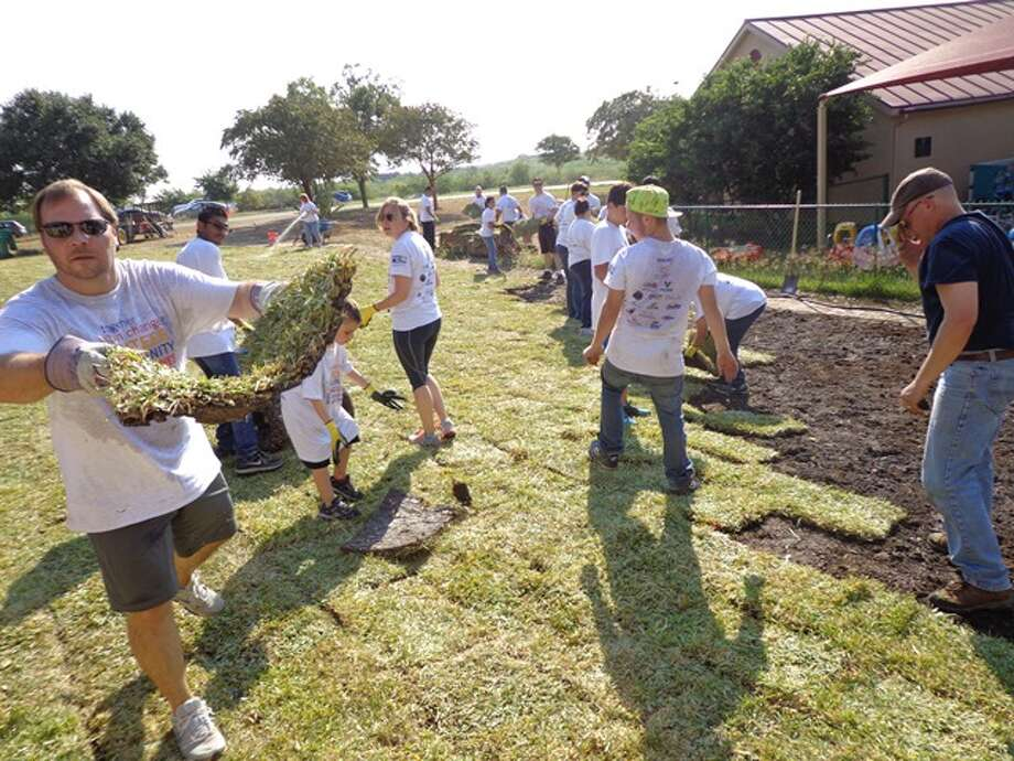 DaVita teammate Chuck Curry helps lays sod at Boysville on Sept. 26. More than 100 DaVita employees and their families volunteered to help restore the Boysville grounds as part of the United Way of Bexar County's Annual Days of Caring. Photo: Courtesy Photo