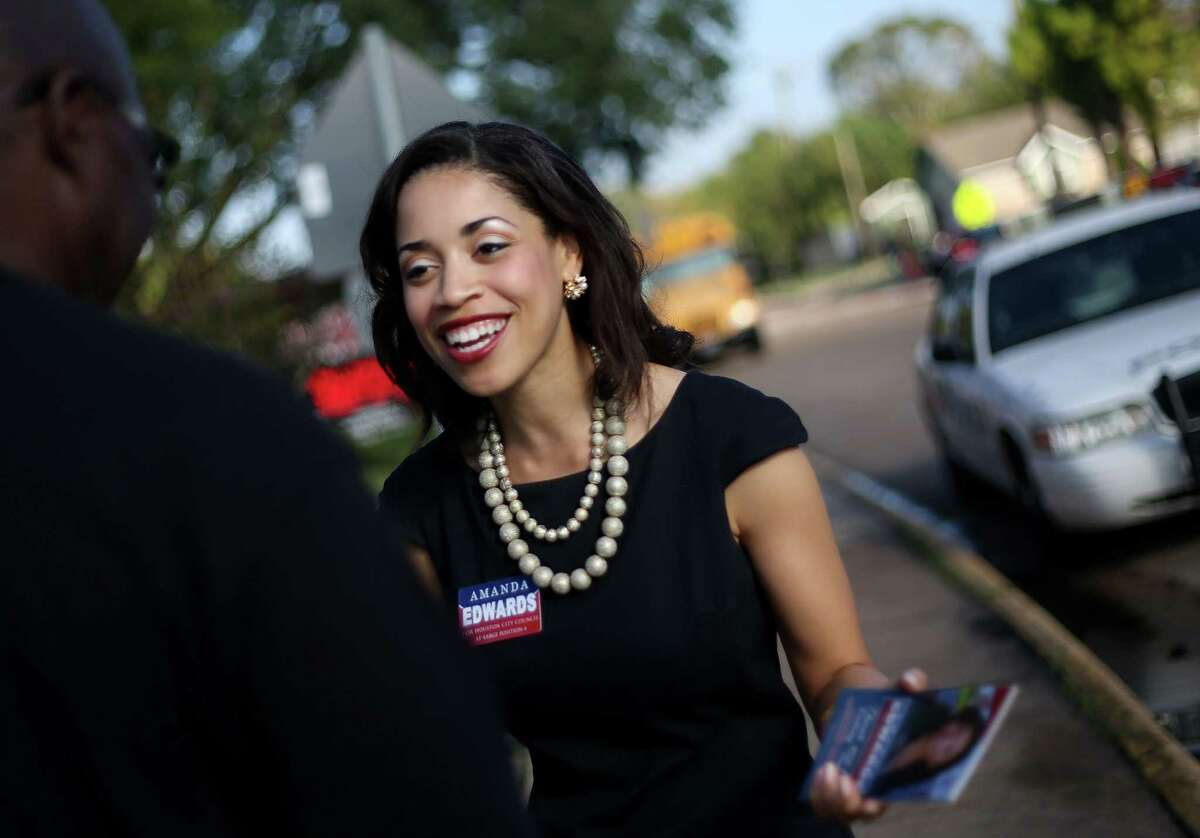 Council candidate Amanda Edwards talks to voters in front of a polling station located in Windsor Village Elementary School on Tuesday, Nov. 3, 2015, in Houston. ( Elizabeth Conley / Houston Chronicle )