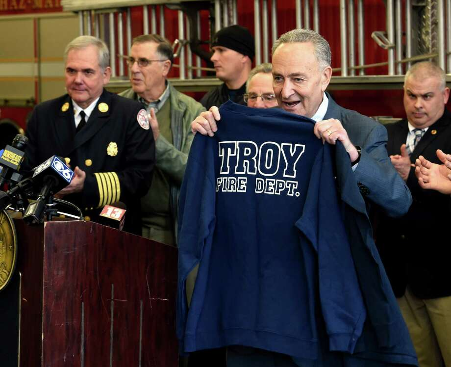 Senator Charles Schumer ended his 17th annual 62 county tour Monday Nov. 30, 2015 at the Troy Fire Deparment Central Station in Troy, N.Y. with the announcement that he is pushing for critical grant money for the Sfaffing for Adequate Fire & Emergency Response program to assist local fire departments to purchase new equipment and train new firefighters.  He also received a gift of a Troy Fire Department sweatshirt that he said will gladly use while working out.     (Skip Dickstein/Times Union) Photo: SKIP DICKSTEIN / 10034459A