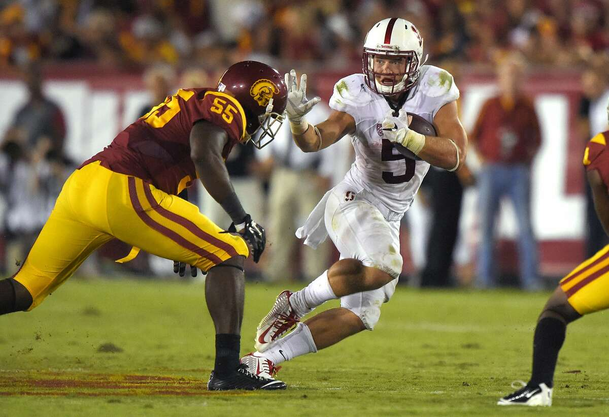 Stanford running back Christian McCaffrey, right, avoids a tackle by Southern California linebacker Lamar Dawson during the second half of an NCAA college football game, Saturday, Sept. 19, 2015, in Los Angeles. Stanford won 41-31. (AP Photo/Mark J. Terrill)