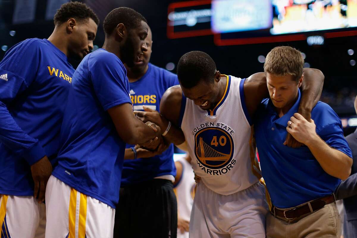 Harrison Barnes #40 of the Golden State Warriors is helped off the court after an injury during the second half of the NBA game against the Phoenix Suns at Talking Stick Resort Arena on November 27, 2015 in Phoenix, Arizona. The Warriors defeated the Suns 135-116.