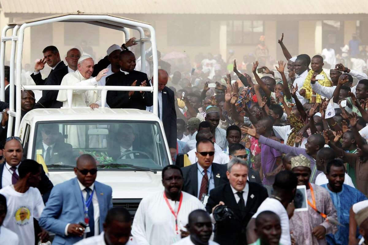 Central AfricanRepublic2014 GDP: 1.723 billion U.S. dollars Pictured: Pope Francis waves to the crowd on the occasion of his visit at the Central Mosque in Bangui's Muslim enclave of PK5, Central African Republic, Monday Nov. 30, 2015. The Pope was welcomed by a crowd of people and prayed inside the Central Mosque.
