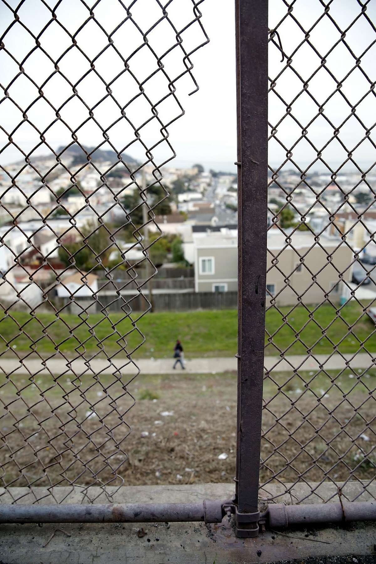 A gap in a chain link fence police suspect was cut to allow the thieves to remove the bicycles from Visitacion Valley Middle School in San Francisco, California, on Monday, Nov. 30, 2015.