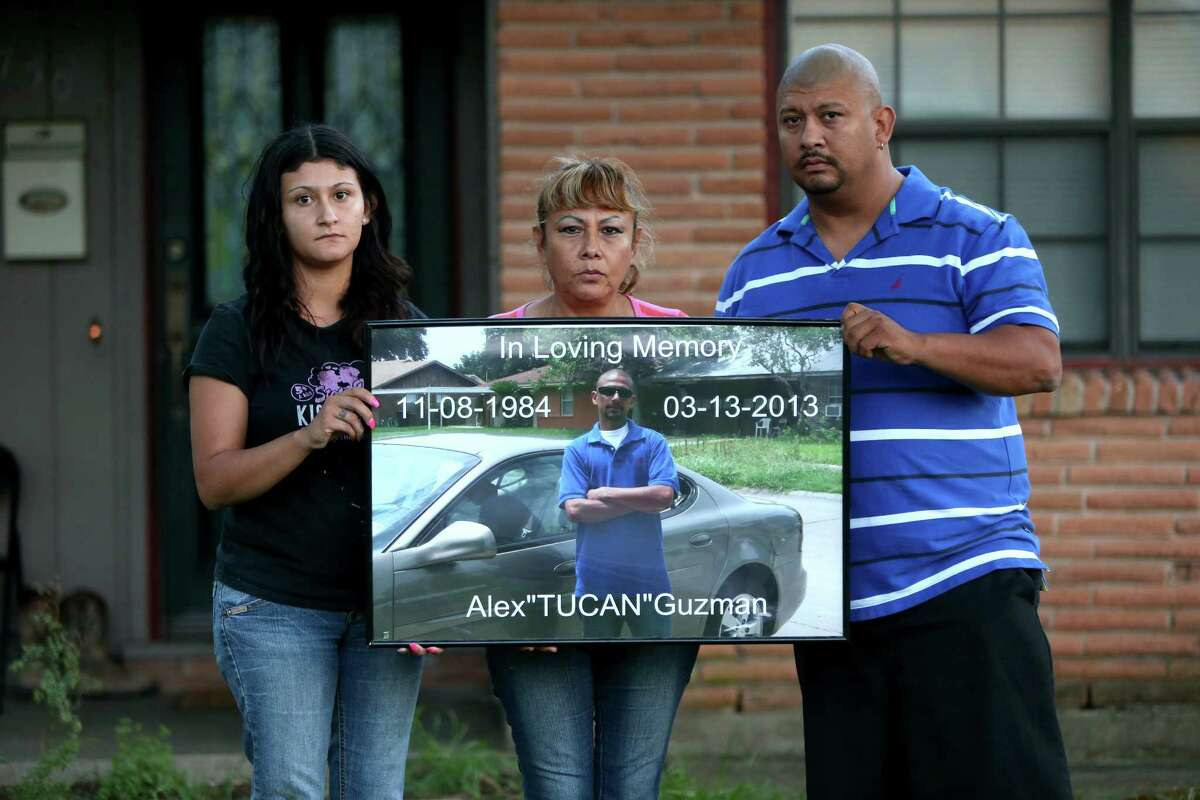 Family members display a photo of Alex Guzman, who killed himself in the Harris County Jail. From left are Yuliana Romero, Blanca Enriquez and Carlos Guzman.