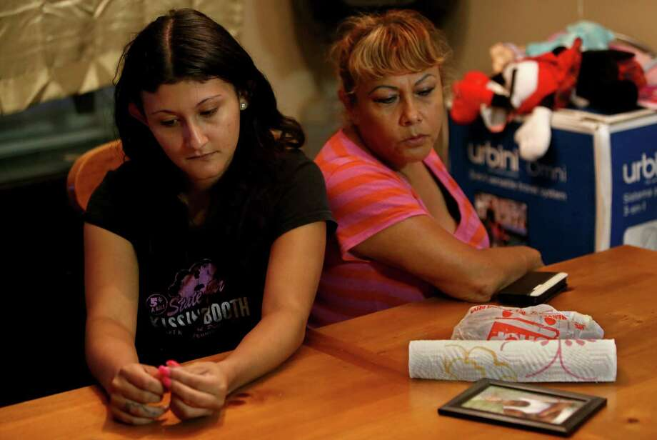 """Alex Guzman's sister, Yuliana Romero, and mother, Blanca Enriquez, remain haunted by his suicide two years ago. """"They should have been more careful,"""" Romero says about the jailers on duty. """"That was their job. To be checking, not to be eating."""" Photo: Gary Coronado, Staff / © 2015 Houston Chronicle"""