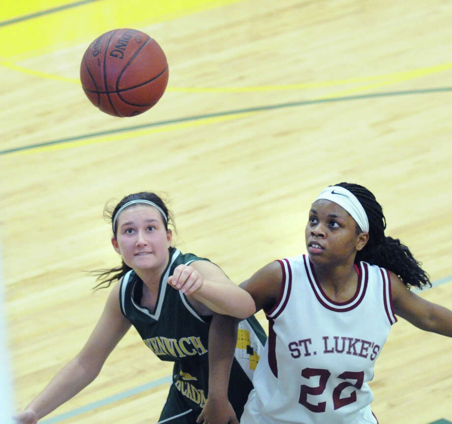 Greenwich Academy's Jordan Fischetti, left and St. Luke's Sydney Lowery battle for a rebound during a game last season. Photo: Bob Luckey / Hearst Connecticut Media / Greenwich Time