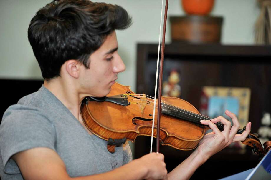 Brian Kaether, a Westhill High School sophomore, is an award-winning violinist who recently attended a nationwide competition in Nashville, where he placed second. Photo: Michael Cummo / Hearst Connecticut Media / Stamford Advocate