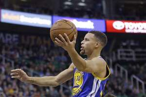 Warriors squeak past Jazz — streak grows to 19 - Photo