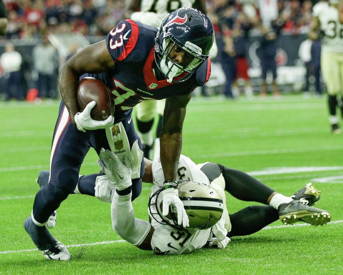 Texans rookie running back Akeem Hunt (33), tripped up by Saints safety Jairus Byrd on Sunday, impressed coach Bill O'Brien by quickly picking up the system.