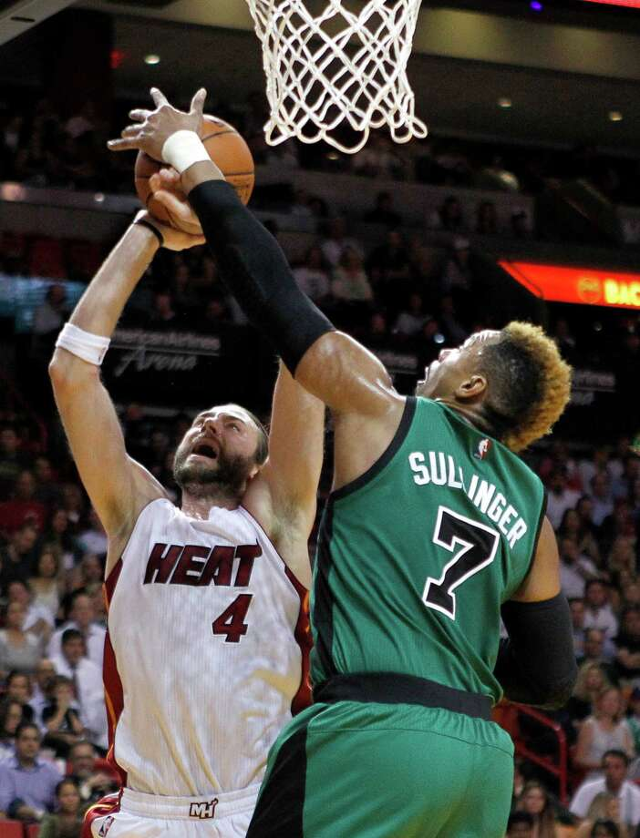 Miami Heat forward Josh McRoberts (4) has his shot blocked by Boston Celtics center Jared Sullinger (7) during the second quarter of an NBA basketball game Monday, Nov. 30, 2015, in Miami. (AP Photo/Joe Skipper) ORG XMIT: FLJS103 Photo: Joe Skipper / FR171174 AP