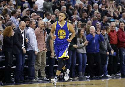 813971b4640 Golden State Warriors guard Stephen Curry (30) runs back to his bench after  making a 3-pointer against the Utah Jazz in the second half during an NBA  ...