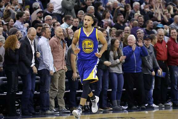 Golden State Warriors guard Stephen Curry (30) runs back to his bench after making a 3-pointer against the Utah Jazz in the second half during an NBA basketball game Monday, Nov. 30, 2015, in Salt Lake City. Warriors won 106-103. (AP Photo/Rick Bowmer)