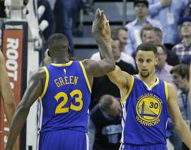 Golden State Warriors' Draymond Green (23) high-fives Golden State Warriors guard Stephen Curry (30) in the second half during an NBA basketball game against the Utah Jazz Monday, Nov. 30, 2015, in Salt Lake City. Warriors won 106-103. (AP Photo/Rick Bowmer)
