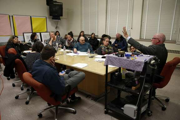 Charles Wilson, Deputy Network Superintendent for Middle Schools, speaks during community meeting about school assignment changes at Roosevelt Middle School in Oakland, Calif., on Monday, November 30, 2015.