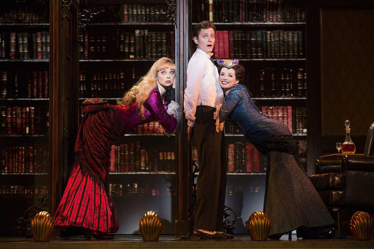 """Aspiring heir Monty Navarro (Kevin Massey, center) has to balance the interests of his mistress, Sibella Hallward (Kristen Beth Williams, left) and his cousin and fiancee Phoebe D'Ysquith (Adrienne Eller) in the touring company of """"A Gentleman's Guide to love & Murder"""""""