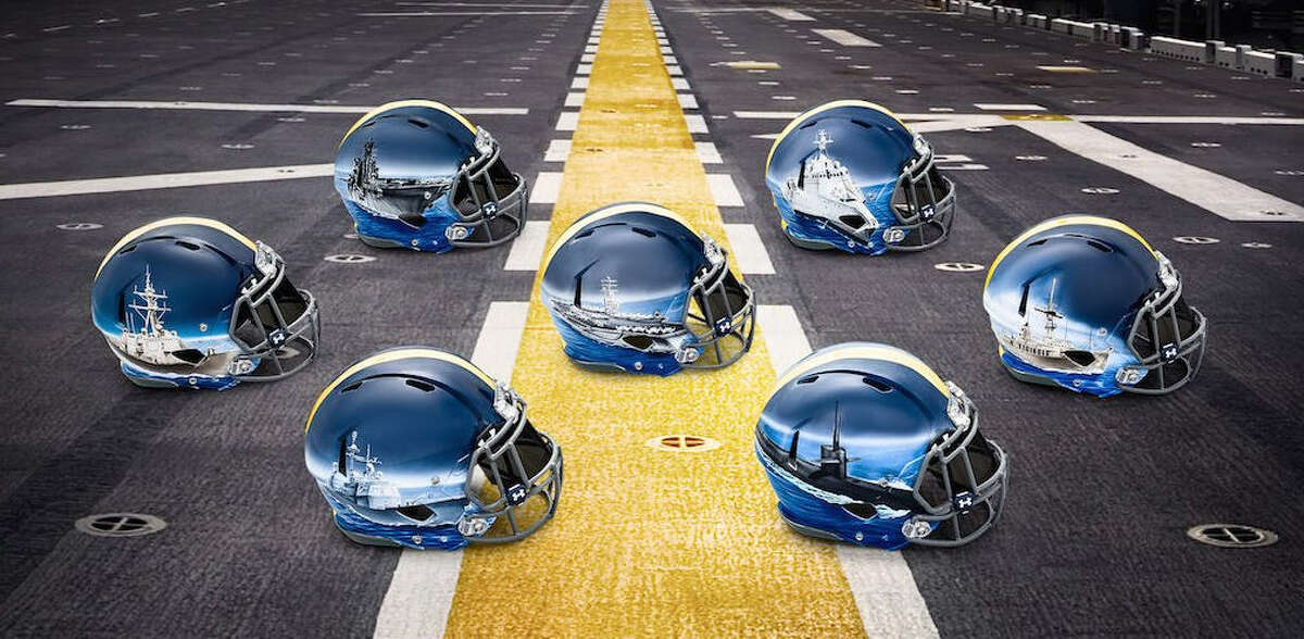 Navy's seven different position groups will each wear different hand-painted helmets for the Navy-Army game on Dec. 12. Browse through the photos to see the details on each helmet.