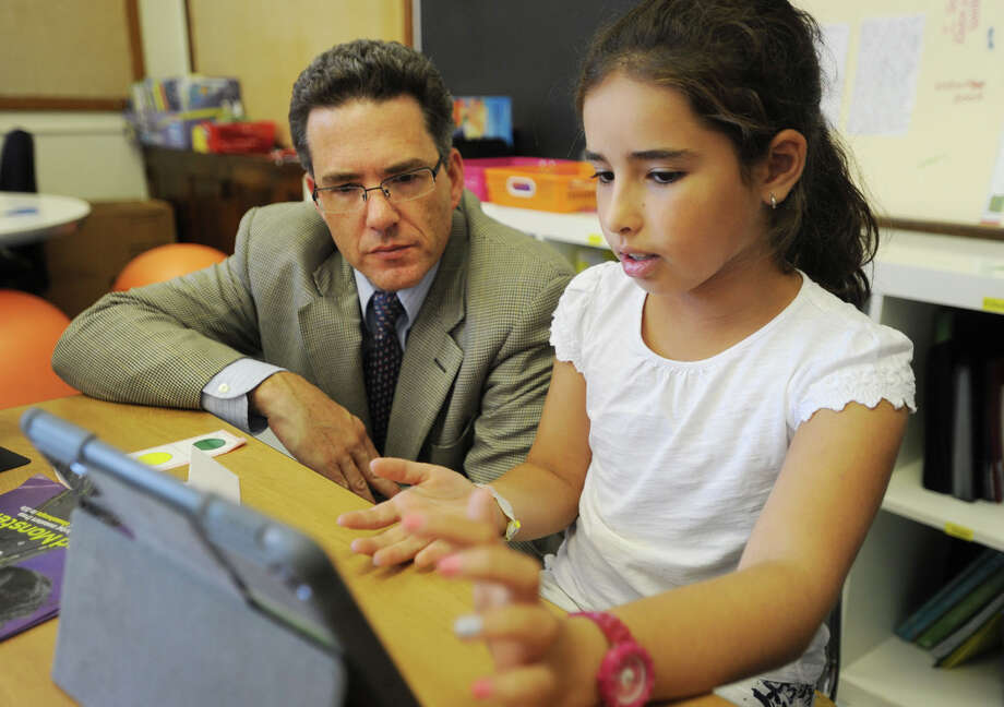 Riverside School Principal Christopher Weiss talks with fifth-grader Sabrina Knoll, as she works on her iPad, during a class earlier this year. Photo: Brian A. Pounds / Hearst Connecticut Media / Connecticut Post