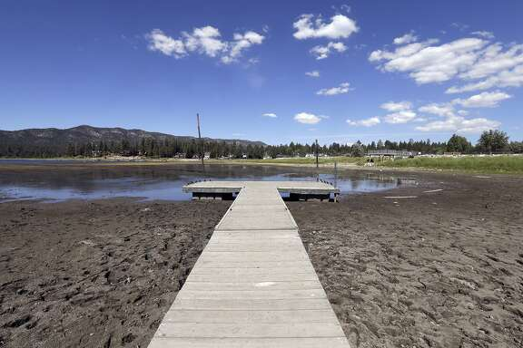 FILE - This Monday, Aug. 24, 2015 file photo shows the lake bed where water has dried due to the drought at Big Bear Lake, Calif. State officials say October's water conservation figures for drought-stricken California are less impressive than in past months. (AP Photo/Nick Ut, File)