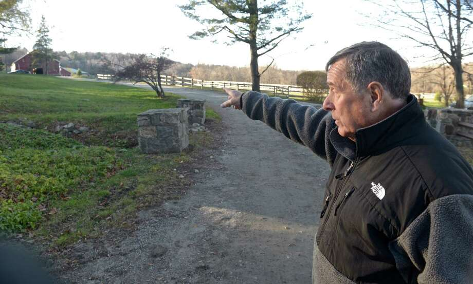 Bob Zupcoe, of Newtown points to a barn where he parked while responding to the crash of Eastern Airline plane in North Salem,  NY, on December 4th, 1965. Zupcoe, who is also a pilot, responded with the Miry Brook Fire Department to the crash. Tuesday, November 17, 2015. Photo: H John Voorhees III / Hearst Connecticut Media / The News-Times