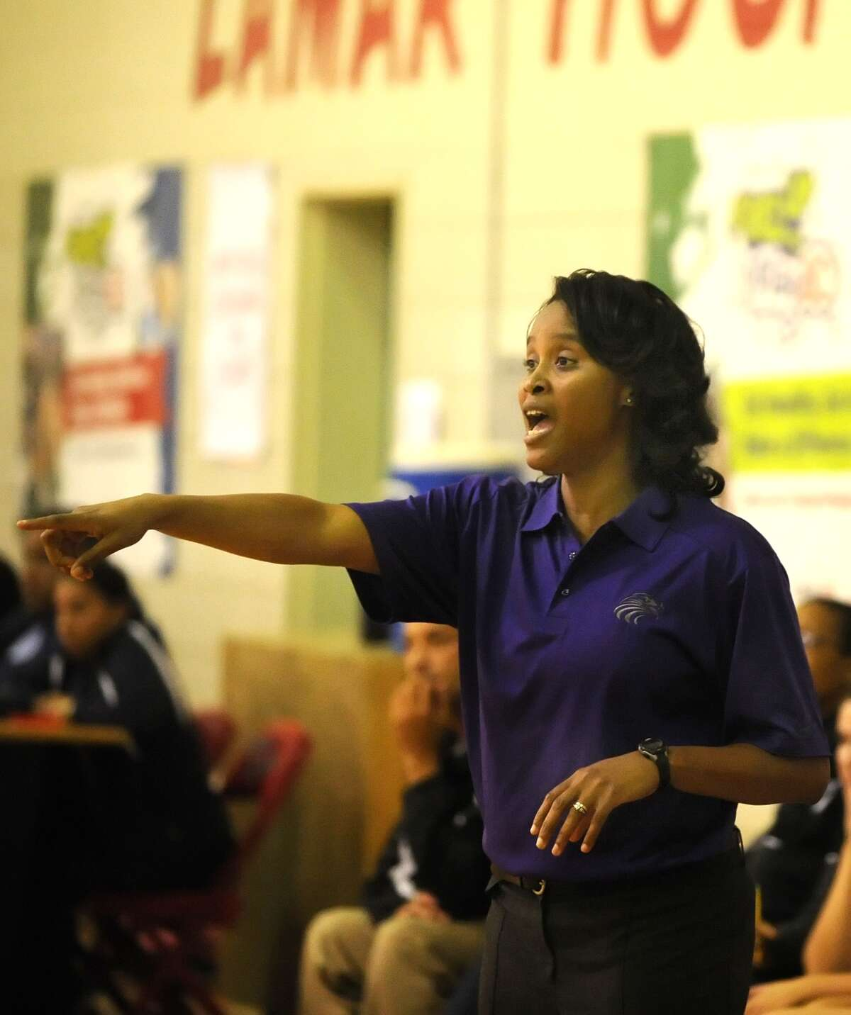 Kinkaid girls basketball team defeated Lamar's girls team, 81-47, at Lamar High School, 11-5-2013. Kinkaid's coach Stacey Marshall yells instructions to the team.