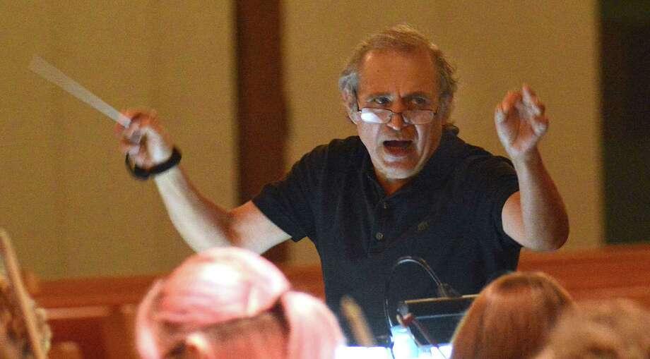 Conductor Reynaldo Ochoa shouts instructions as he leads members of the Symphony North of Houston during rehearsal. Photo: David Hopper, Freelance / freelance