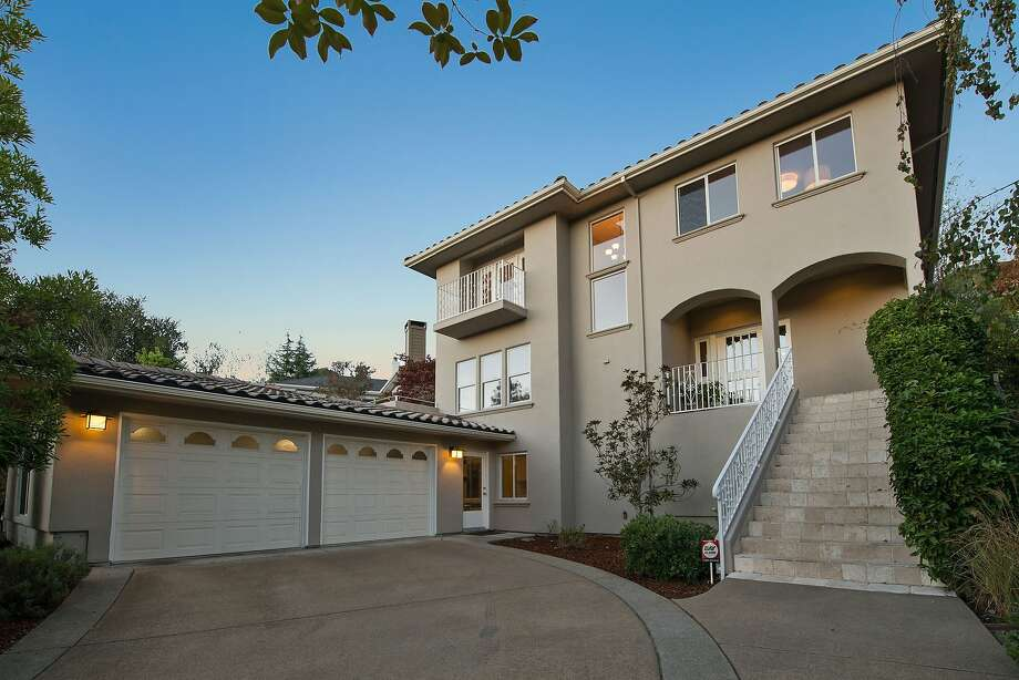1028 Aquarius Way in Oakland's Broadway Terrace neighborhood sits up the road from Lake Temescal Regional Park. Photo: Open Homes Photography