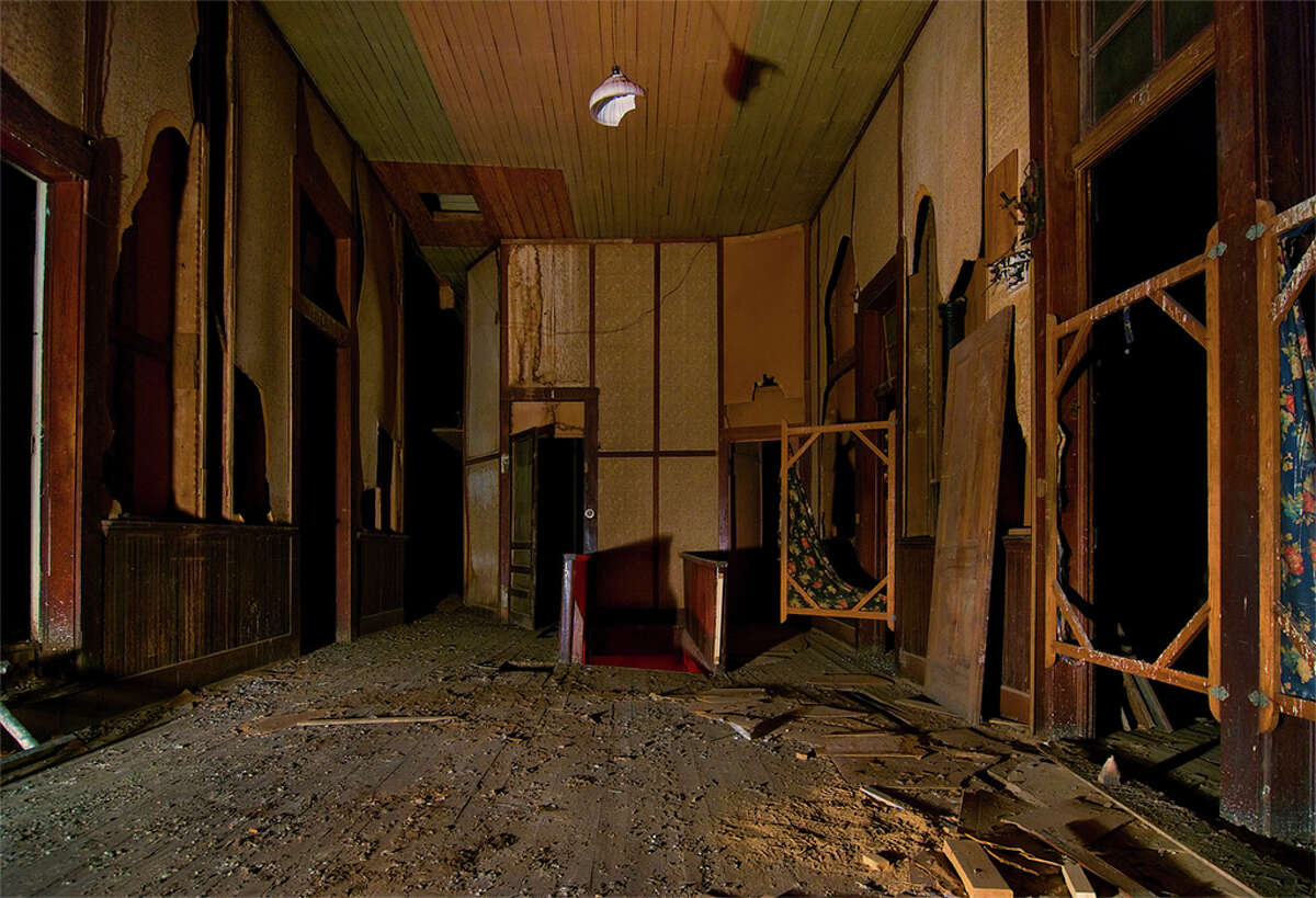 """Inside this abandoned WWII-era brothel in downtown Brownwood, Texas, Kearns found floral-print curtains and pillow cases, old newspapers and empty bottles of """"KnoxIt,"""" believed to be a remedy for Gonorrhea at the time."""