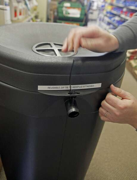 Sales staff Jennifer Titus at The Urban Store explaining the features on  the 50 gallon rain barrel on December 1, 2015. The barrel is being given to qualified San Francisco residents via the PUC. Photo: Franchon Smith, The Chronicle