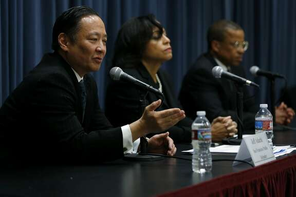 San Francisco Public Defender Jeff Adachi (left) speaks to the media joined by Clothilde Hewlett and Timothy Moppin during a news conference in San Francisco, California, on Tuesday, Dec. 1, 2015.