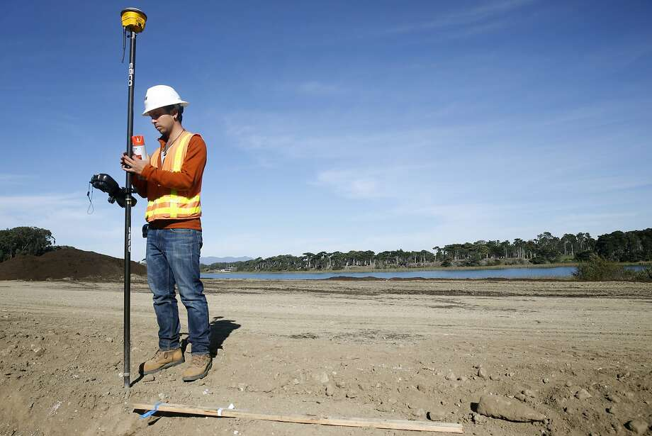 Santiago Ossa uses GPS to take critical elevation readings on the site of the old Pacific Rod and Gun Club at Lake Merced in San Francisco, Calif. on Tuesday, Dec. 1, 2015. The city's Public Utilities Commission will be seeking proposals for future development on the property beginning next year. Photo: Paul Chinn, The Chronicle