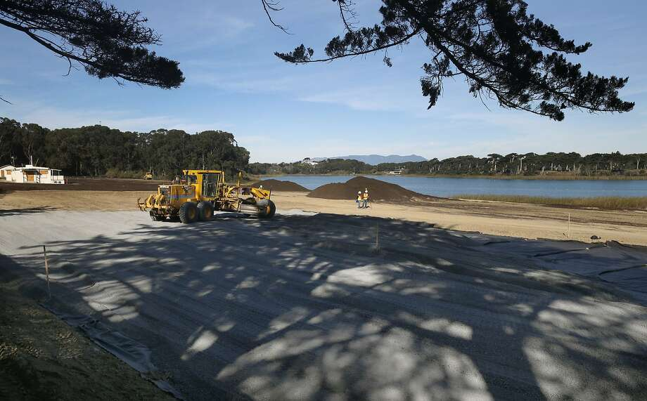 Construction equipment levels gravel and soil during a remediation project on the site of the old Pacific Rod and Gun Club at Lake Merced in San Francisco, Calif. on Tuesday, Dec. 1, 2015. The city's Public Utilities Commission will be seeking proposals for future development on the property beginning next year. Photo: Paul Chinn, The Chronicle