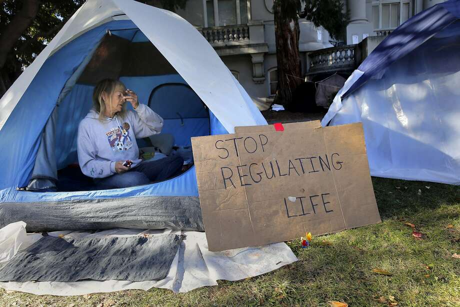 Evelyn Tucker, who occupies one of more than a dozen tents set up on the front lawn, has been living in the camp for the past 12 days. Photo: Michael Macor, The Chronicle