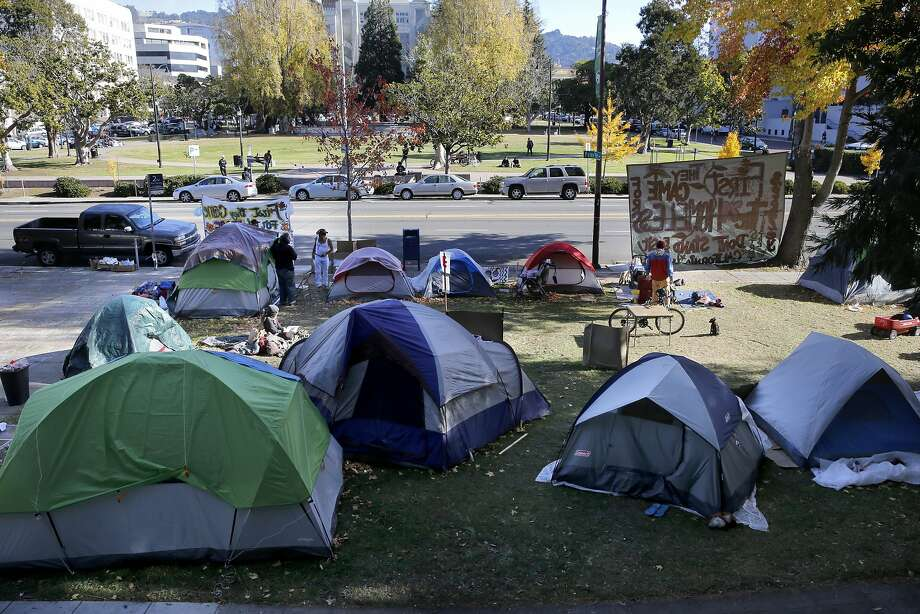 "The homeless have taken over the front lawn outside old City Hall calling their camp, ""Liberty City"", as seen on Tues. December 2, 2015, in Berkeley, Calif., to protest the new homeless ordinances which are up for a final vote tonight before the Berkeley City Council. Photo: Michael Macor, The Chronicle"