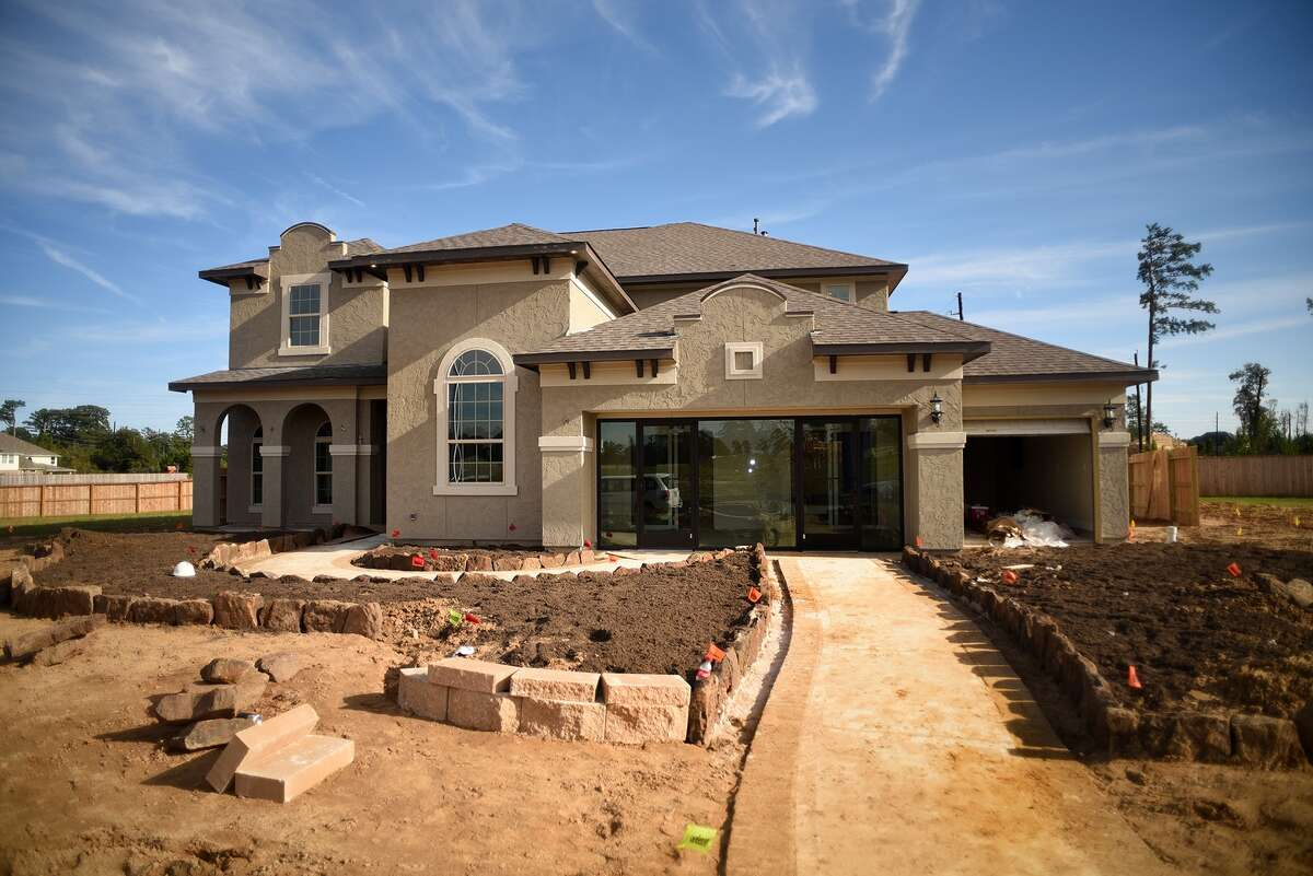 Work continues on a model home by Taylor Morrison Homes in the new Notchwood subdivision in The Woodlands on Nov. 12, 2015. (Photo by Jerry Baker/Freelance)