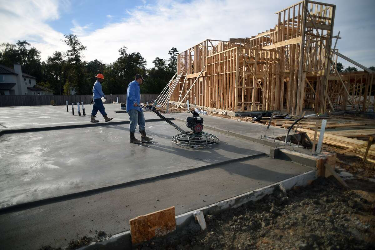 Work continues on Taylor Morrison Homes in the new Notchwood subdivision in The Woodlands on Nov. 12, 2015. (Photo by Jerry Baker/Freelance)