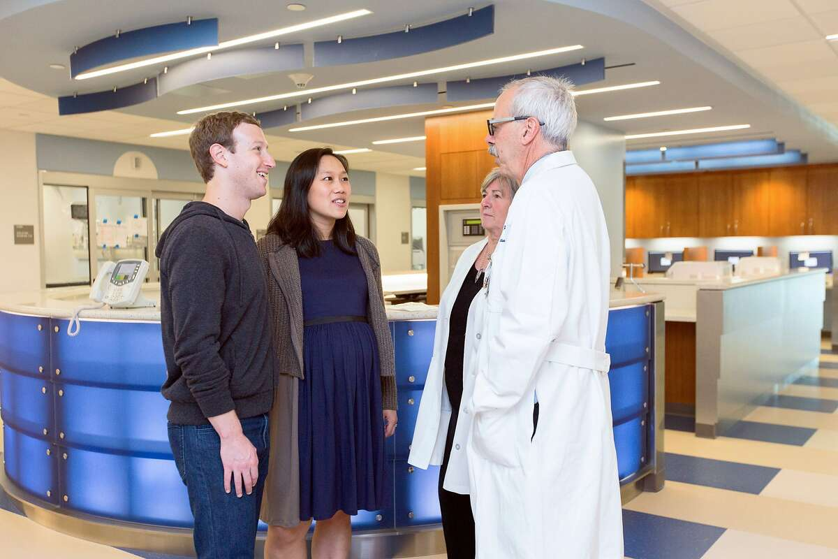 Dr. James Marks, chief of Medical Staff and chief of Anesthesia at Zuckerberg San Francisco General, and Dr. Sue Carlisle, vice dean of UCSF School of Medicine at Zuckerberg San Francisco General, with Mark Zuckerberg and his wife, Dr. Priscilla Chan.