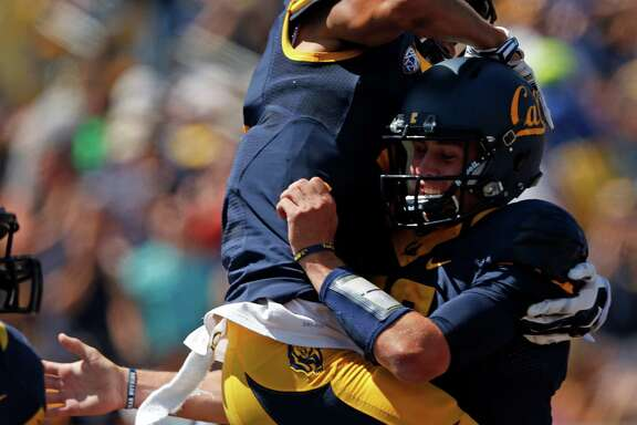 California quarterback Jared Goff (right) celebrates with Kenny Lawler after Lawler's one-handed touchdown catch in 1st quarter against Sacramento State during NCAA College football game at Memorial Stadium in Berkeley, Calif. on Saturday, September 6, 2014.