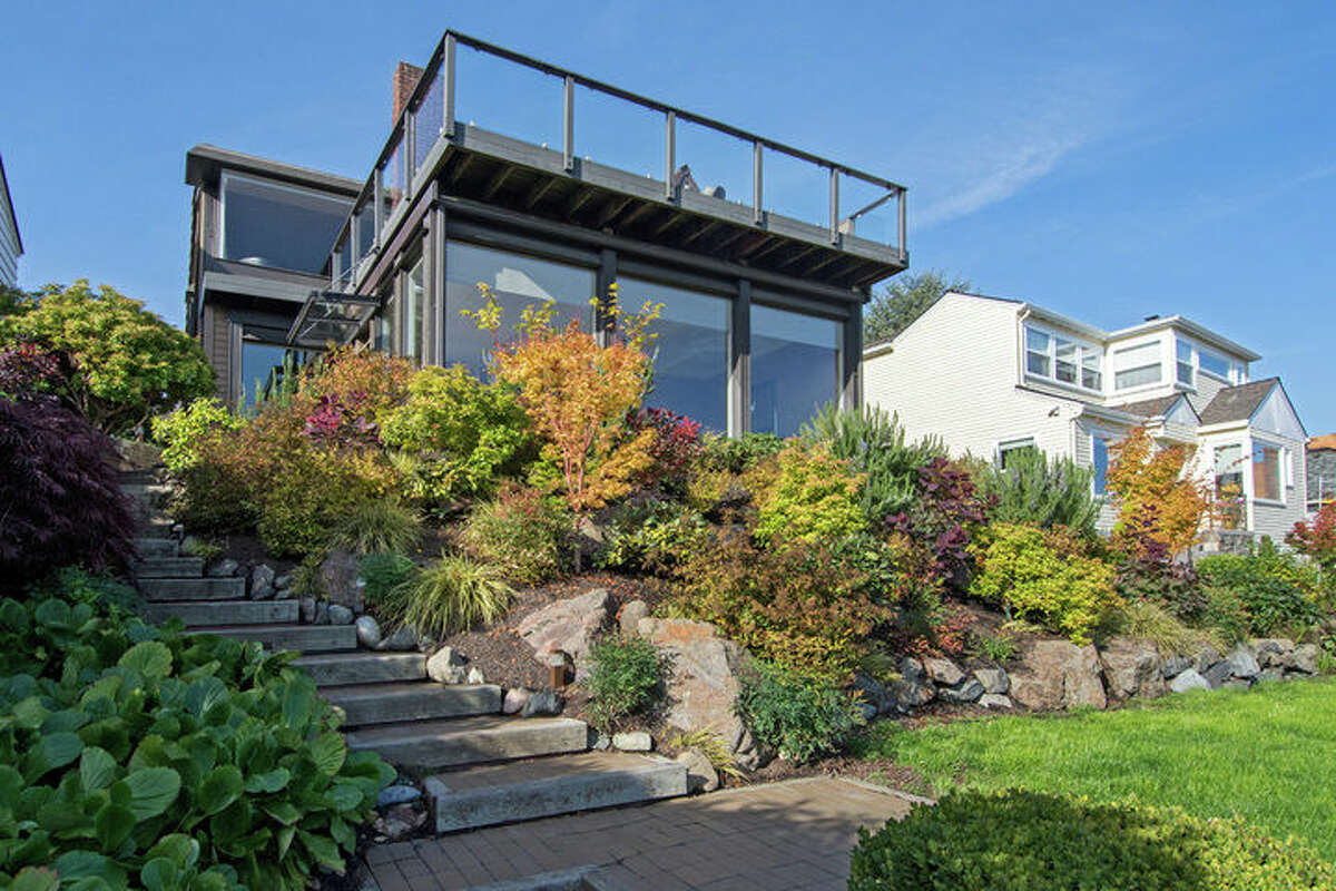 The first home, 2307 Eastmont Way W., is listed for $1.389 million. The five bedroom, 2.75 bathroom home was built in 1927, and features sweeping mountain and Puget Sound views. You can see the full listing here.
