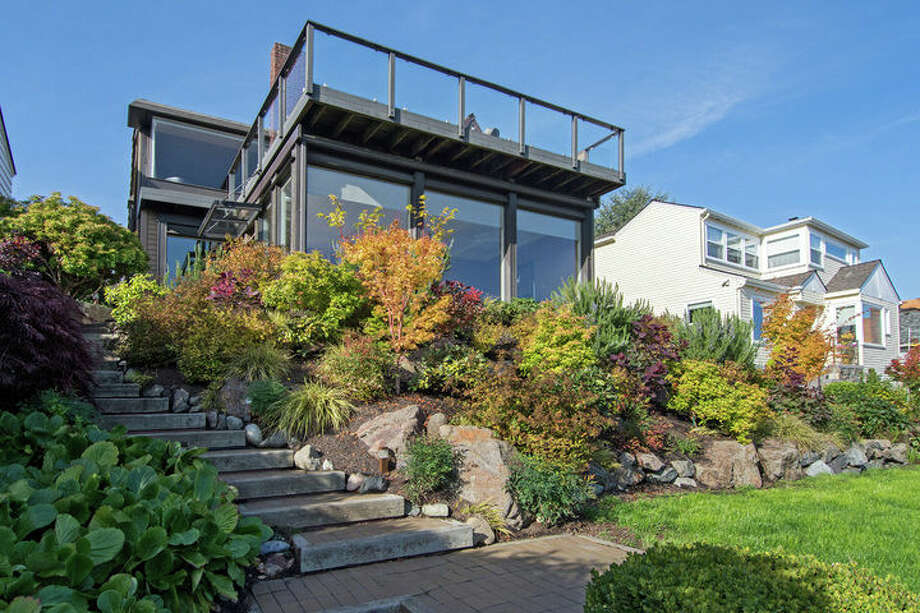 The first home, 2307 Eastmont Way W., is listed for $1.389 million. The five bedroom, 2.75 bathroom home was built in 1927, and features sweeping mountain and Puget Sound views.  You can see the full listing here. Photo: Scott And Molly Shutes/Windermere Real Estate Greenwood