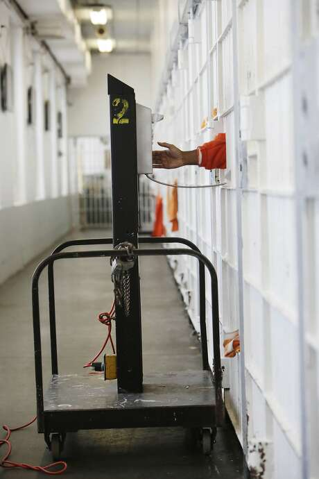 An inmate uses a rollaway phone at the jail at the Hall of Justice on Tuesday, December 1,  2015 in San Francisco, Calif. Photo: Lea Suzuki, The Chronicle