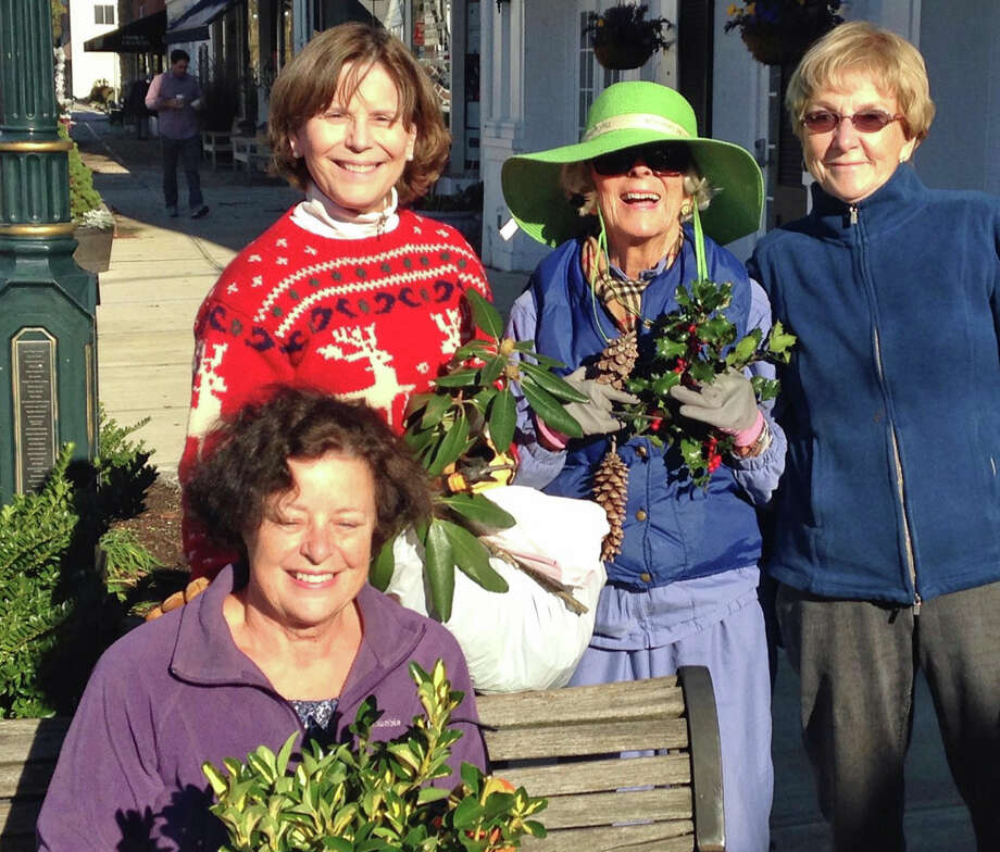 Standing L to R: Betsy Kreuter, Nancy Harris, Laura Howe. Seated: Mary Bishop.Twenty members lead by Betsy Kreuter, Chairman of Civic Committee of the Garden Club of Old Greenwich arranged different evergreens and decorations in the  Old Greenwich merchants' planters and window boxes. The planters are changed three times a year to reflect the seasons. This is one of the many Garden Club of Old Greenwich projects which are supported by proceeds from its annual plant sale. Photo: Contributed / Contributed Photo / Greenwich Time Contributed