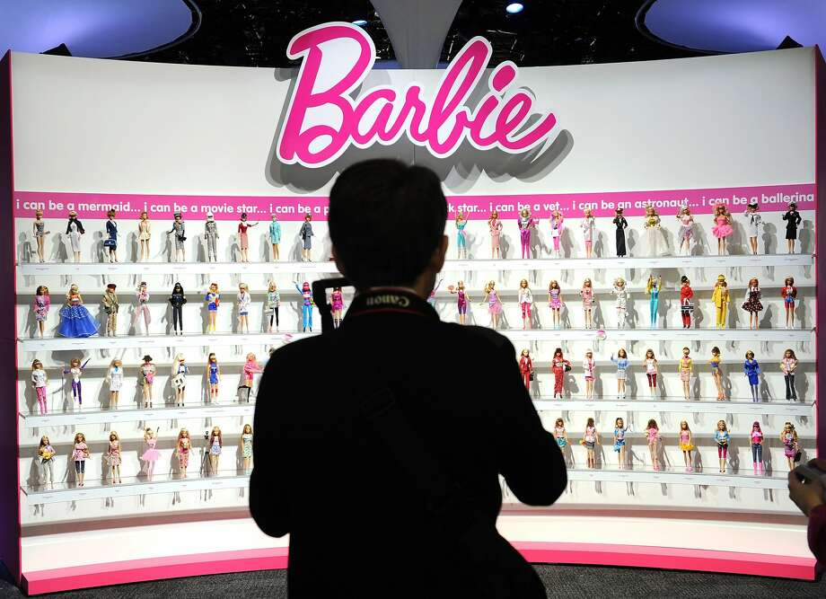 Unlike these traditional Barbie dolls, Hello Barbie can converse with children through the Internet. Photo: Stan Honda, AFP / Getty Images