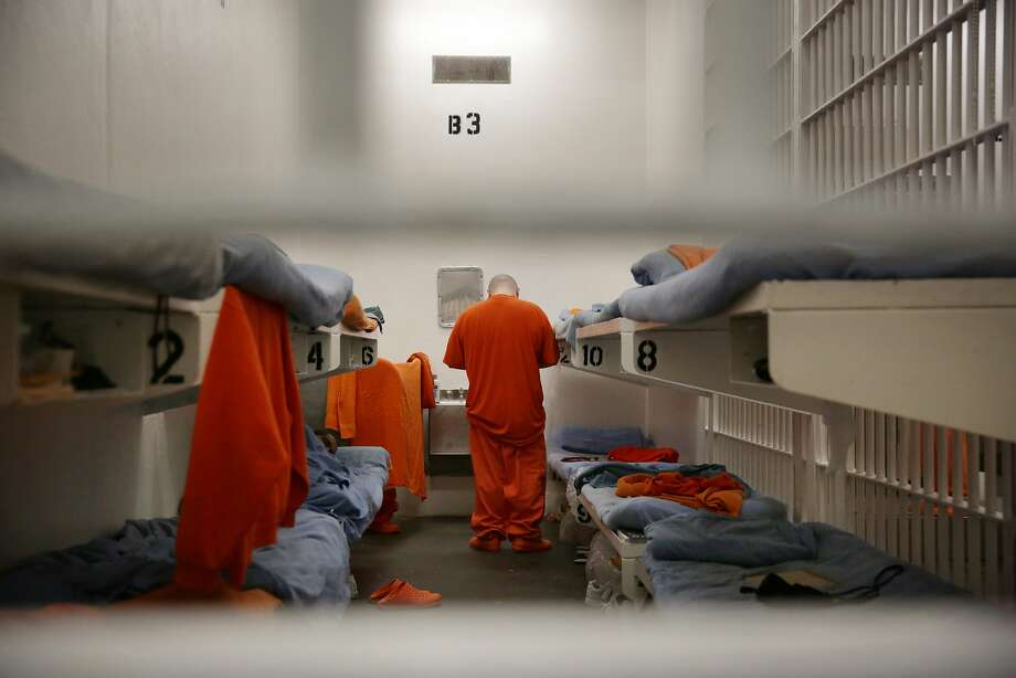 Inmates are seen through bars on the front of a cell on the main line at the  jail at the Hall of Justice on Tuesday, December 1,  2015 in San Francisco, Calif. Photo: Lea Suzuki, The Chronicle