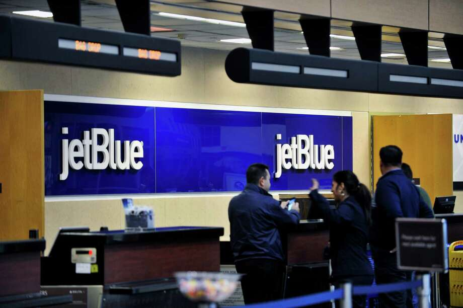 Crews work setting up the ticket counter of JetBlue airlines at the Albany International Airport on Tuesday, Dec. 2, 2015, in Colonie, N.Y.  (Paul Buckowski / Times Union) Photo: PAUL BUCKOWSKI / 10034503A