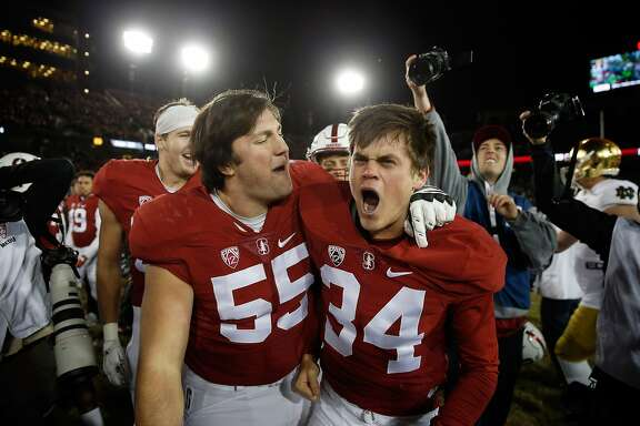 PALO ALTO, CA - NOVEMBER 28:  Conrad Ukropina #34 of the Stanford Cardinal celebrates with Nate Lohn #55 after he kicked the game-winning field at the end of regulation to beat the Notre Dame Fighting Irish  at Stanford Stadium on November 28, 2015 in Palo Alto, California.  (Photo by Ezra Shaw/Getty Images)