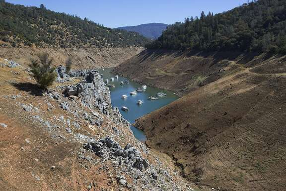 FILE -- Lake Oroville, where water levels have dropped 254 feet, in northern California, Sept. 19, 2015. The severe drought in California and the resulting receding water levels have exposed hundreds of archaeological sites that were once underwater to opportunistic looting. (Ruth Fremson/The New York Times)