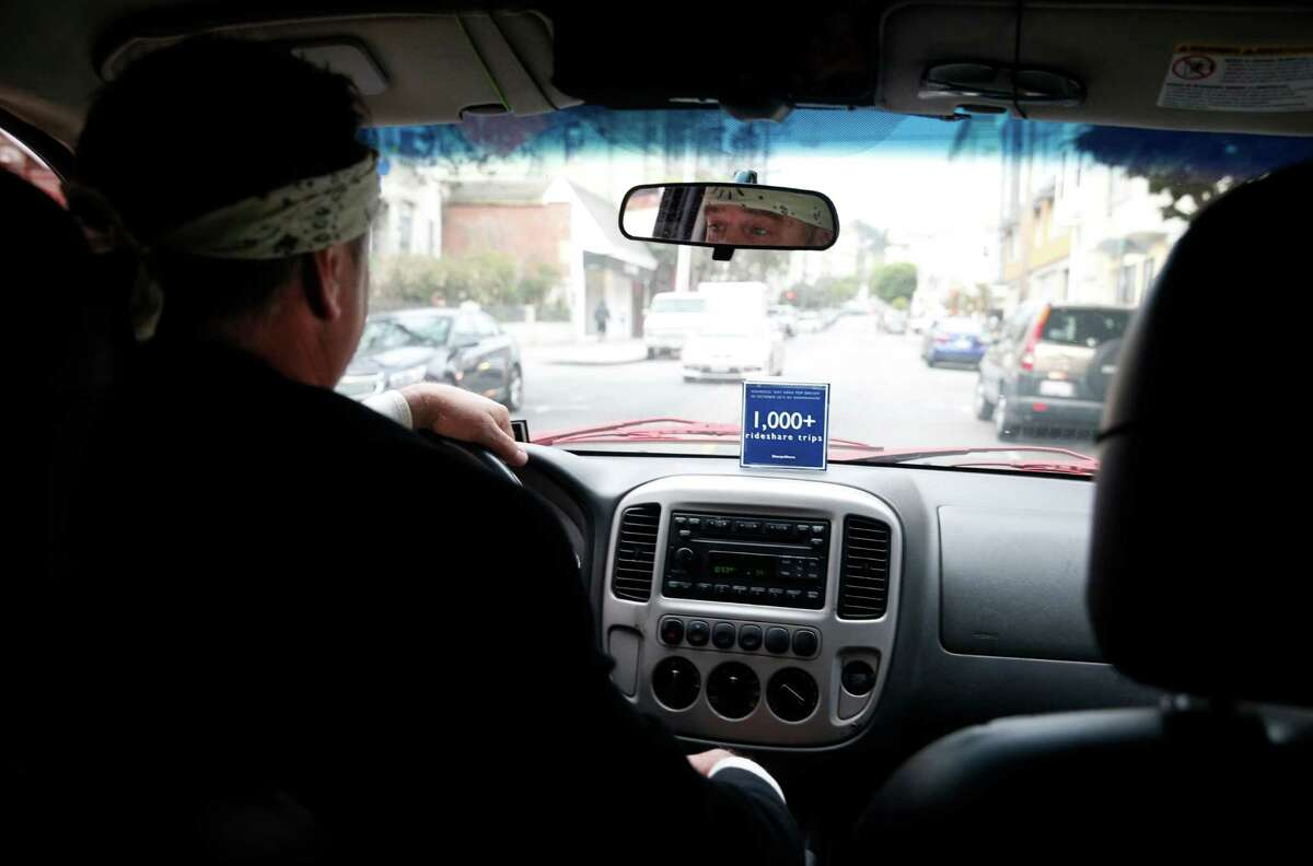 Uber driver John Sollars in the Mission District last month. Uber said it is cutting San Francisco rates for UberPool, its shared-ride option, during commuting hours starting Tuesday.