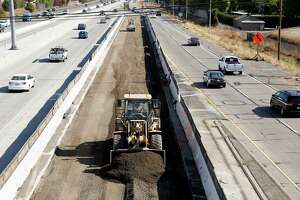 FILE - In this Oct. 15, 2015 file photo, vehicles pass a highway construction site on eastbound Interstate 80 in Sacramento, Calif. The House and Senate have reached agreement on a 5-year, $281 billion transportation bill that would increase spending to address the nation's aging and congested highways and transit systems _ a legislative feat that lawmakers and President Barack Obama have struggled throughout his entire administration to achieve.  (AP Photo/Rich Pedroncelli, File)